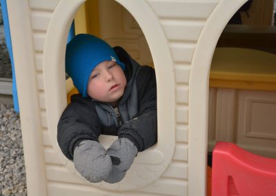 Boy in play house